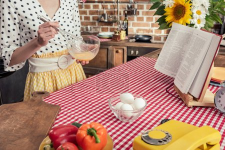 Photo for Cropped shot of housewife whisking eggs for omelette at kitchen - Royalty Free Image