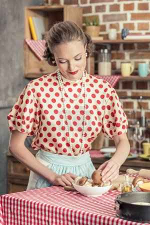 beautiful adult housewife with raw mushrooms cooking at kitchen