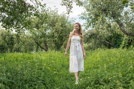 beautiful elegant woman in apple garden
