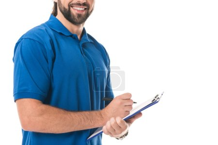 cropped shot of smiling delivery man writing on clipboard isolated on white