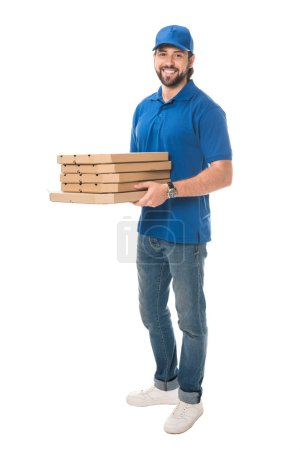 full length view of happy delivery man holding boxes with pizza and smiling at camera isolated on white
