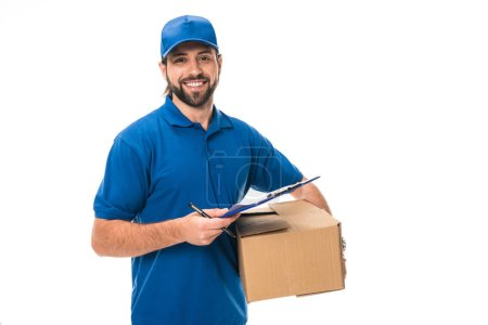 happy young delivery man holding clipboard and cardboard box isolated on white