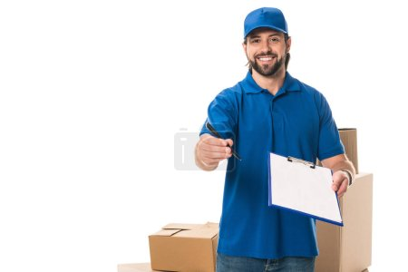 handsome young delivery man holding clipboard and smiling at camera isolated on white