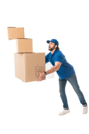 delivery man holding stack of cardboard boxes isolated on white
