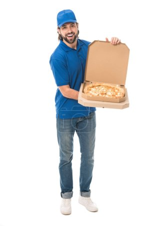 handsome delivery man holding pizza in boxes and smiling at camera isolated on white