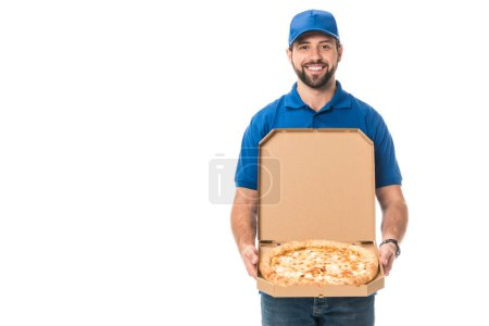 handsome delivery man holding pizza in box and smiling at camera isolated on white