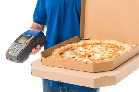 cropped shot of delivery man holding pizza in boxes and mobile terminal isolated on white
