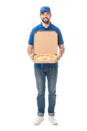 happy delivery man holding pizza in box and smiling at camera isolated on white