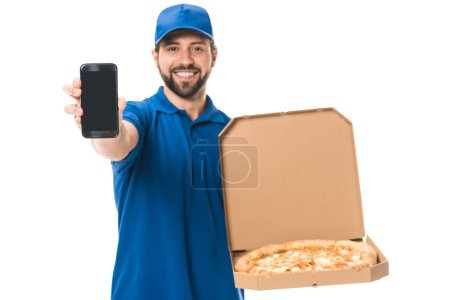 happy delivery man holding smartphone and pizza in box isolated on white