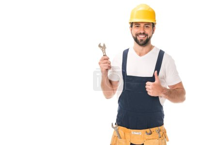 Photo for Handsome happy workman holding wrench and showing thumb up isolated on white - Royalty Free Image