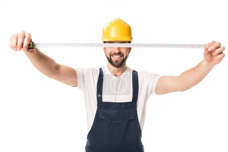 handsome happy workman holding measuring tape isolated on white