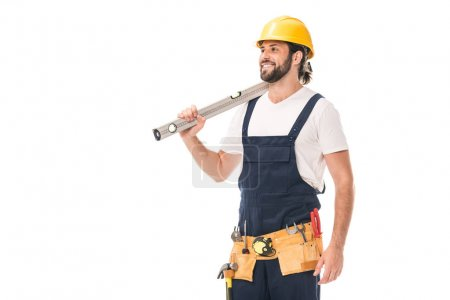 Foto de Feliz guapo trabajador explotación nivel herramienta y mirando lejos aislaron en blanco - Imagen libre de derechos