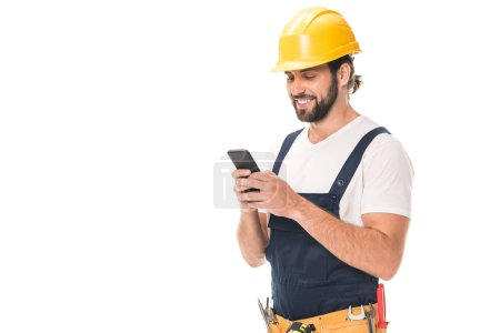 Photo for Happy workman in hard hat using smartphone isolated on white - Royalty Free Image
