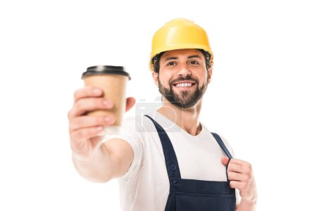 close-up view of smiling workman holding paper cup with coffee to go isolated on white