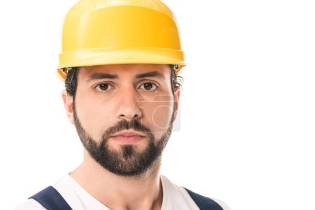 close-up view of handsome workman in hard hat looking at camera isolated on white