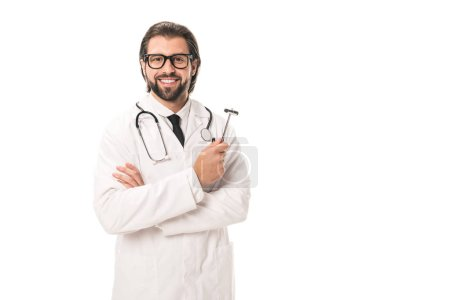 handsome bearded doctor in white coat and eyeglasses holding reflex hammer and smiling at camera isolated on white
