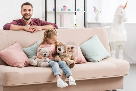 Photo for Father and daughter having fun on sofa - Royalty Free Image