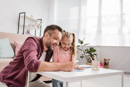 Photo for Father and blonde daughter drawing at home - Royalty Free Image