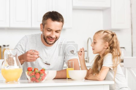 Photo for Father and daughter having breakfast at kitchen - Royalty Free Image