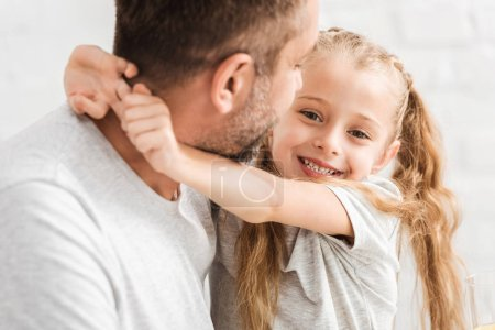 Photo for Father and daughter hugging one another - Royalty Free Image