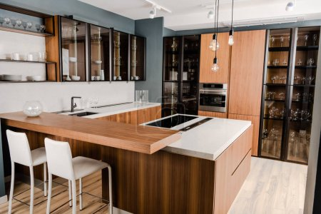 interior of luxury wooden kitchen with comfortable furniture and many shelves