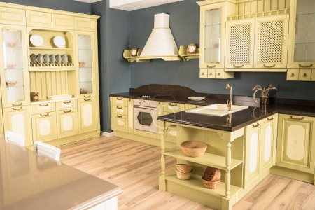 interior of modern green light kitchen with comfortable furniture and wooden floor