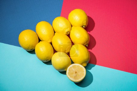 lemons in triangle figure on blue, turquoise and pink background