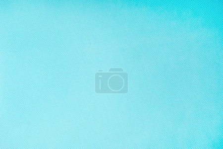 top view of white polka dots on turquoise background