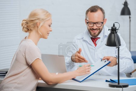 female patient having appointment with chiropractic in clinic