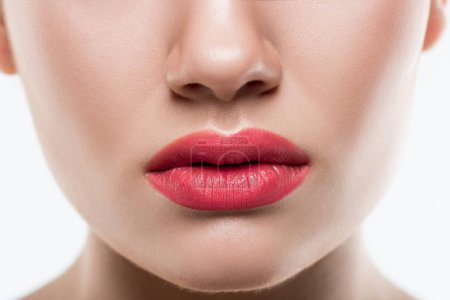 cropped view of young woman with pink lips, isolated on white