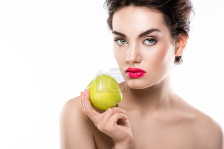 attractive girl holding green organic apple, isolated on white