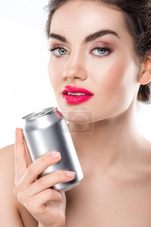 young smiling woman holding soda can, isolated on white