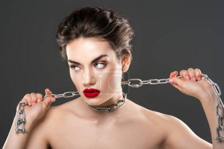 beautiful passionate woman with chain on neck, isolated on grey