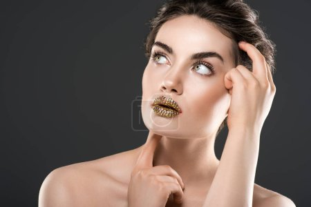 fashionable girl with golden lips, isolated on grey