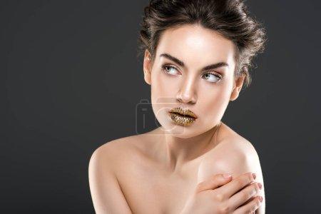 elegant fashionable nude girl with golden lips, isolated on grey