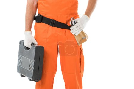 Foto de Imagen recortada de mecánico de automóviles en uniforme naranja con caja de herramientas aislada en blanco - Imagen libre de derechos