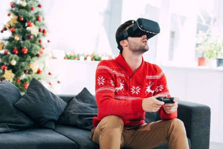 man with virtual reality headset and joystick playing video game on christmas eve