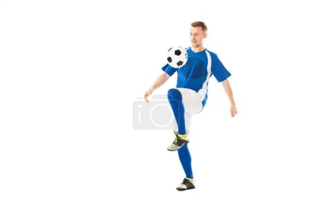 Photo for Full length view of athletic young sportsman in soccer uniform training with ball isolated on white - Royalty Free Image