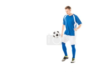 Photo for Full length view of handsome young soccer player training with ball isolated on white - Royalty Free Image