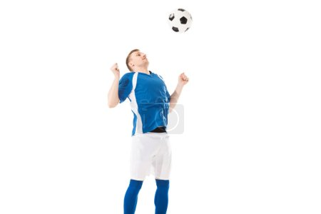 athletic young soccer player hitting ball with chest isolated on white