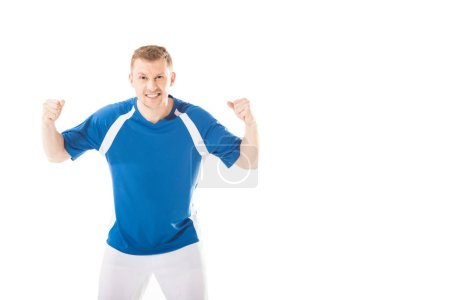 emotional young soccer player shaking fists and looking at camera isolated on white