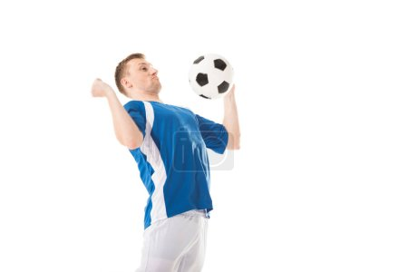 young soccer player hitting ball with chest isolated on white