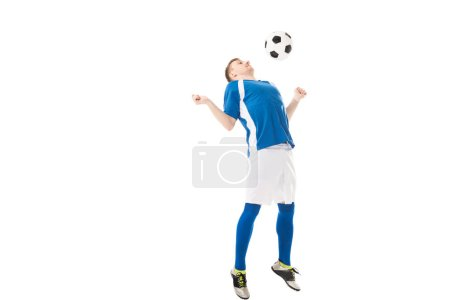 full length view of young soccer player hitting ball with chest isolated on white