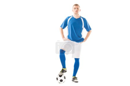 Photo for Confident young soccer player standing with hands on hips and looking at camera isolated on white - Royalty Free Image