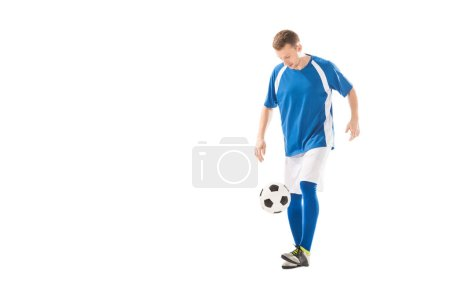 full length view of young sportsman playing with soccer ball isolated on white
