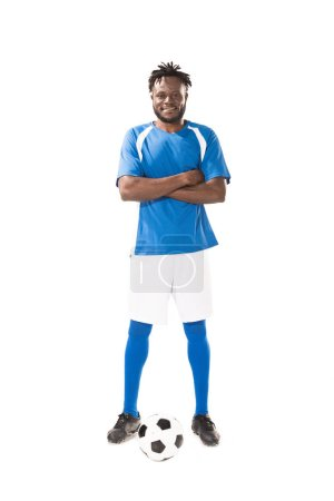 full length view of smiling african american soccer player standing with crossed arms and looking at camera isolated on white