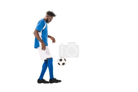 athletic african american sportsman playing with soccer ball isolated on white