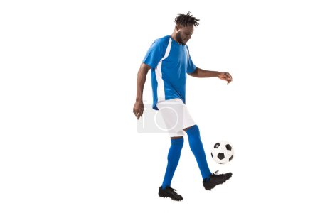 side view of athletic african american sportsman playing with soccer ball isolated on white