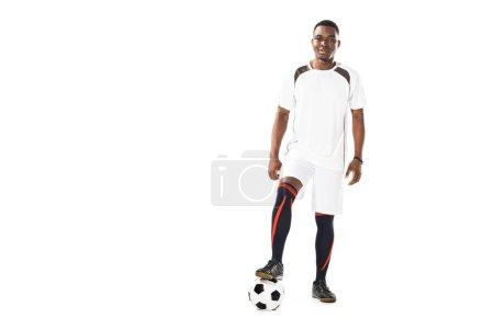 Photo for Handsome young african american sportsman standing with soccer ball and smiling at camera isolated on white - Royalty Free Image
