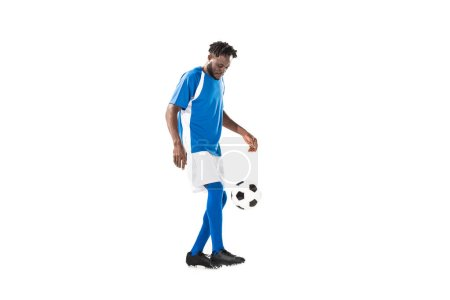 side view of african american sportsman playing with soccer ball isolated on white